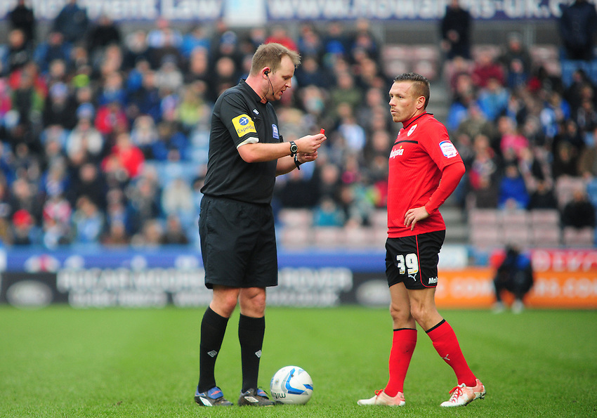 Referee Mark Brown talks to Cardiff City's Craig Bellamy ahead of a free kick..Football - npower Football League Championship - Huddersfield Town v Cardiff City  - Saturday 9th February 2013 - John Smith's Stadium - Huddersfield..