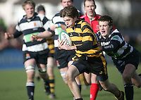 R.B.A.I. fullback Andrew Bryans on the attack during the Northern Bank Schools Cup Final at Ravenhill. Result Wallace 0pts R.B.A.I. 15pts.
