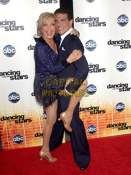"""FLORENCE HENDERSON & CORKY BALLAS .""""Dancing With The Stars"""" Season Premiere held at CBS Studios, Los Angeles, CA, USA..September 20th, 2010.full length black blue dress beads beaded posing leg up dance suit side mouth open.CAP/RKE/DVS.©DVS/RockinExposures/Capital Pictures."""