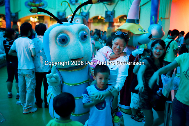 SHENZHEN, CHINA SEPTEMBER 29: Performers greet children after a Disney themed show at Happy Valley Theme park on September 29, 2008 in central Shenzhen, China. The park has various attractions such as roller coasters, water rides and Walt Disney style live shows for children. Chinese people love theme parks and new ones are opening constantly. It's estimated that there's about 2400 theme parks in the country. Many of the most popular parks are located around Shenzhen and over the border in Hong Kong. (Photo by Per-Anders Pettersson)..