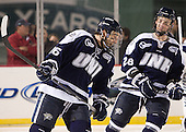 John Henrion (UNH - 16), Grayson Downing (UNH - 28) - The University of Maine Black Bears defeated the University of New Hampshire Wildcats 5-4 in overtime on Saturday, January 7, 2012, at Fenway Park in Boston, Massachusetts.