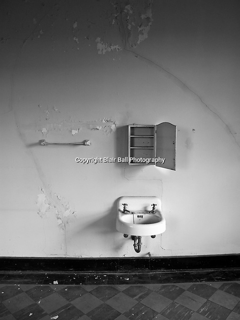 Sink, towel rack and medicine cabinet in abandoned dormitory catholic schoolhouse in Vicksburg Mississippi