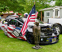 Westside Eagle Observer/RANDY MOLL This car on display Saturday in Highfill highlights the show's purpose in raising funds to support local veteran organizations.