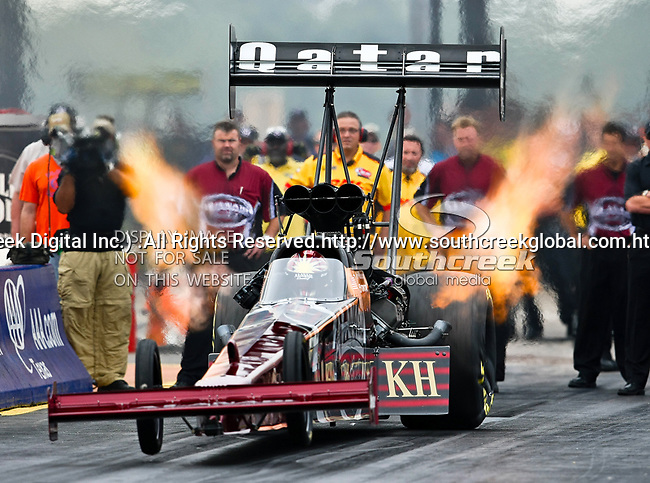 Larry Dixon #2, driver for Al-Anabi Racing's Top Fuel Dragster makes a  run at the O'Reilly Fall Nationals held at the Texas Motorplex in  Ennis, Texas.