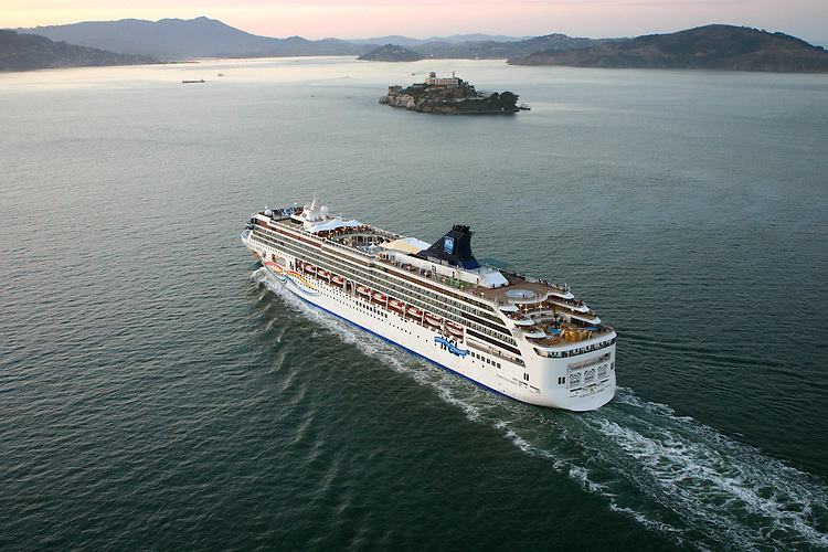 October 29, 2005; San Francisco, CA, USA; Aerial view of a cruise ship leaving the port of San Francisco in front of Alcatraz Island at sunset in San Francisco Bay. Photo by: Phillip Carter