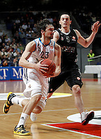 Real Madrid's Sergio Llull and Brose's Karsten Tadda during Euroliga match. February 28,2013.(ALTERPHOTOS/Alconada)