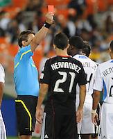 MLS referee Alex Prus gives DC United forward Jaime Moreno and San Jose Earthquakes Brandon McDonald a red card..  San Jose Earthquakes defeated DC United 2-0 at RFK Stadium, October 9, 2010.