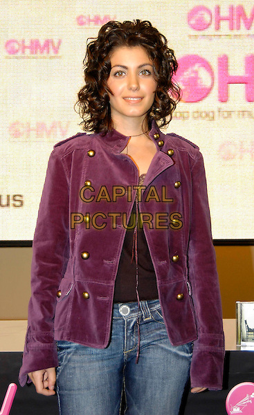 KATIE MELUA.Instore gig & signing at HMV, 150 Oxford Street, W1, London..September 26th, 2005.half length purple jacket .www.capitalpictures.com.sales@capitalpictures.com.©Capital Pictures
