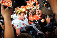 07 October 2006: Texas defensive end Brian Robison mugs for the media cameras while wearing the Golden Hat Trophy after the Longhorns 28-10 victory over the University of Oklahoma Sooners at the Cotton Bowl in Dallas, TX.