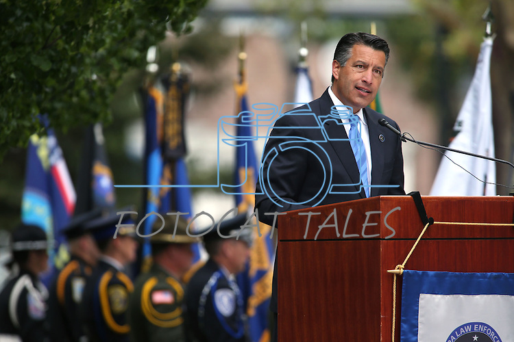 Nevada Gov. Brian Sandoval speaks at the annual Nevada Law Enforcement Officers Memorial Ceremony on the Capitol Mall in Carson City, Nev., on Thursday, May 7, 2015.<br /> Photo by Cathleen Allison
