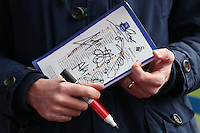 Detail shot of the match day programme covered in players autographs as a fan waits to collect more signatures ahead of the Barclays Premier League match between Everton and Swansea City played at Goodison Park, Liverpool