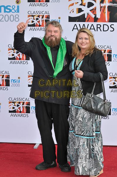 BRIAN BLESSED.Arrivals for the Classical Brit Awards 2008 held at the Royal Albert Hall, London, England, UK, 8th May 2008..full length beard facial hair green scarf suit black and white zebra print patterned dress long maxi bag jacket thumb up.CAP/CAN.© Phil Loftus/Capital Pictures