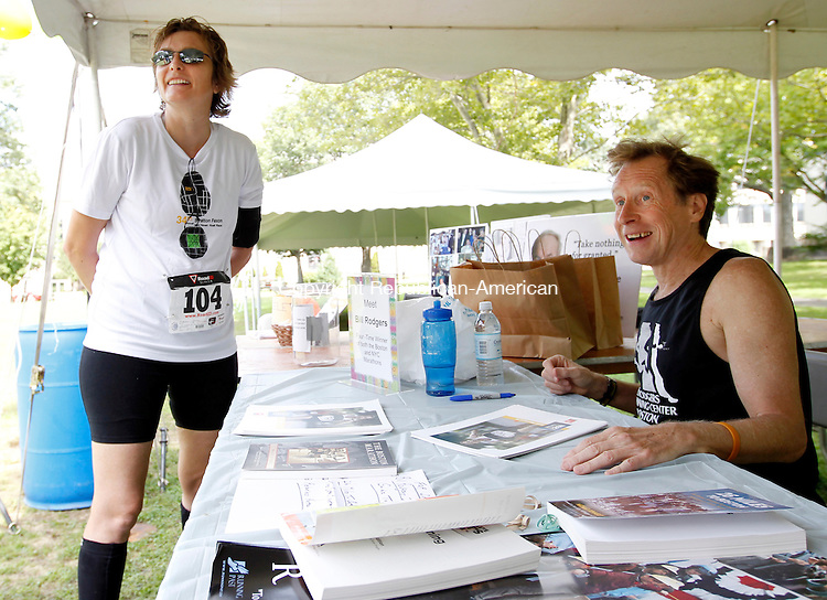 Waterbury, CT- 11, September 2011-091111CM14  Carole Urban, of Milford chats with runner legend Bill Rodgers before the start of the Bob Veillette 5k Sunday afternoon in Waterbury.  The race benefits Veillette, a former managing editor at the Republican-American newspaper was paralyzed from the nose down following a stroke in April 2006.  Christopher Massa Republican-American
