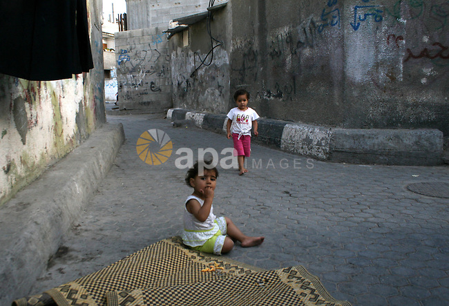 Palestinian refugee children play at the narrow roads of  El-Shateaa refugee camp, in Gaza City. Palestinian refugees still dream to come back to their houses inside the green line which occupied by Israel in 1948 , as they set to mark the sixtieth anniversary of the catastrophe (Israel foundation) on May 15. The United Nations is set to halt delivery of humanitarian aid to the Gaza Strip today because its vehicles have run out of fuel, a UN official said..