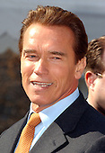 Washington, DC - February 22, 2004 -- California Governor Arnold Schwarzenegger makes remarks to the press following a meeting of the National Governors Association in the State Dining Room at the White House in Washington, D.C. on February 23, 2004.  The governors heard some remarks from United States President George W. Bush and were able to ask him some questions..Credit: Ron Sachs / CNP