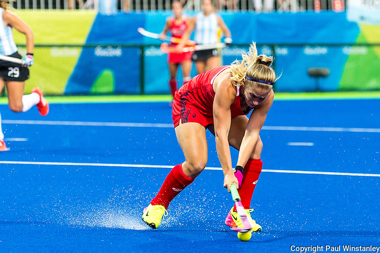 Katie Bam #16 of United States takes a reverse stick shot during Argentina vs  USA at the Rio 2016 Olympics at the Olympic Hockey Centre in Rio de Janeiro, Brazil.