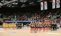 28.01.2017 The Silver Ferns and Diamonds line up for the anthems before the Silver Ferns v Australian Diamonds netball test match played at the International Convention Centre studium in Durban, South Africa.<br />  Mandatory Photo Credit ©Reg Caldecott/Michael Bradley Photography.
