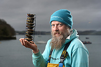 BNPS.co.uk (01202) 558833. <br /> Pic: ZacharyCulpin/BNPS<br /> <br /> Oyster gatherer Christopher Ranger with one of his oyster racks he plans to use on the hatchery. The rack helps oysters reproduce.<br /> <br /> The Lone Ranger - A concerned oyster fisherman is crowdfunding to set up his very own 'micro-hatchery' in a bid to restore the UK's dwindling stocks of the shellfish.<br /> <br /> Chris Ranger, 44, currently runs Britain's last surviving oyster fishery on the River Fal in Mylor Churchtown, Cornwall.<br /> <br /> The site has been a hotbed for oyster activity for thousands of years but they are now on the brink of vanishing after years of overfishing.