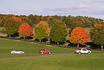 A row of cars waits to leave the site at the end of the day at the annual Winchester Balloon Festival.  Long Branch Farm, Winchester, Virginia, USA.  © RickCollier.com.