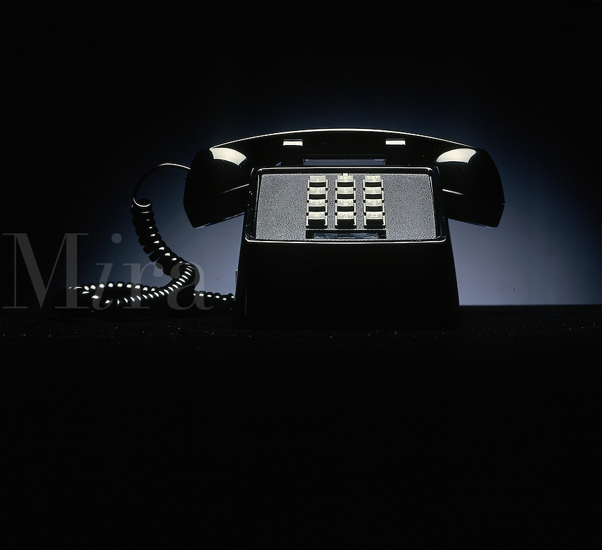 Basic black single-line pushbutton telephone.