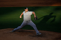 Joba Chamberlain #62 of the New York Yankees pitches against the Los Angeles Angels at Angel Stadium on June 15, 2013 in Anaheim, California. (Larry Goren/Four Seam Images)