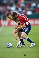Chivas USA forward Justin Braun (17) battles Philadelphia Union defender Cristian Arrieta (26) for the ball during the first half of the game between Chivas USA and the Philadelphia Union at the Home Depot Center in Carson, CA, on July 3, 2010. Chivas USA 1, Philadelphia Union 1.