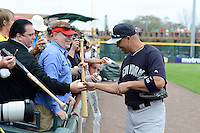 Outfielder Carlos Beltran (36) of the New York Yankees signs autographs before a spring training game against the Pittsburgh Pirates on February 26, 2014 at McKechnie Field in Bradenton, Florida.  Pittsburgh defeated New York 6-5.  (Mike Janes/Four Seam Images)