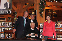 George W. Bush With Wife Laura Billy Graham And Son Franklin<br /> At Library Book Signing Charlotte North Carolina USA<br /> By Jonathan Green