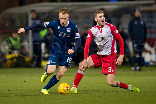 30th November 2019; Dens Park, Dundee, Scotland; Scottish Championship Football, Dundee Football Club versus Queen of the South; Danny Johnson of Dundee goes past Kevin Holt of Queen of the South  - Editorial Use