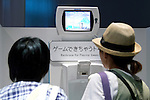 """Visitors play a washroom video game at the Toilet!? Human Waste & Earth's Future exposition on August 1, 2014 in Tokyo, Japan. The Toilet!? Human Waste & Earth's Future is an exposition to listen the toilet's voice and explore what is the """"happy toilet"""" for each human being on the earth at National Museum of Emerging Science and Innovation in Tokyo from July 2 to October 5. The toilet is related not only to our daily life but also to the global environment. The exposition consist of eight areas where you can learn toilet problems for each generation and in the world. (Photo by Rodrigo Reyes Marin/AFLO)"""