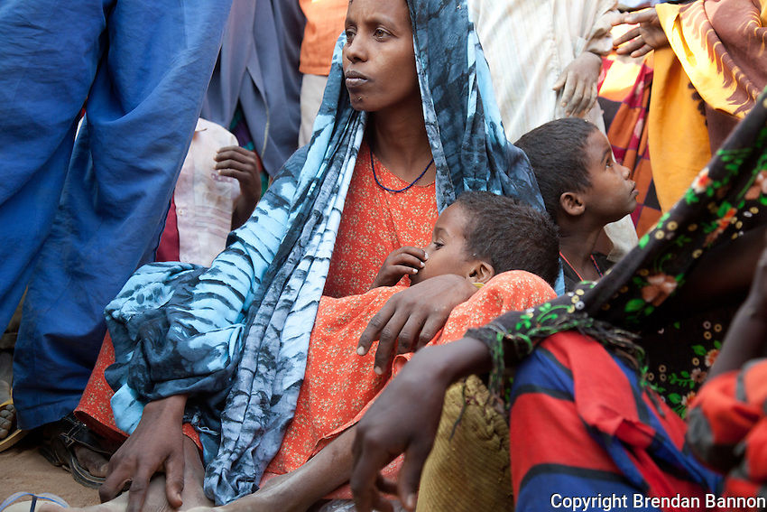 Somali refugees who have just arrived at Dadaab refugee camp wait at a reception area in the first days after arriving. The emergency situation has created a backlog for the registration process, which is key for refugees to get a regular, predictable and adequate supply of food.