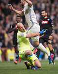 Karim Benzema of Real Madrid collides with Goalkeeper Pepe Reina of SSC Napoli during the match Real Madrid vs Napoli, part of the 2016-17 UEFA Champions League Round of 16 at the Santiago Bernabeu Stadium on 15 February 2017 in Madrid, Spain. Photo by Diego Gonzalez Souto / Power Sport Images