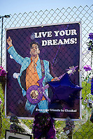 Prince playing his Love Symbol guitar on a Live Your Dream graphic. Paisley Park Studios Chanhassen Minnesota MN USA