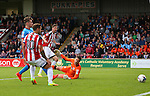 Chris Basham of Sheffield Utd scores the first goal past Luke Daniels of Scunthorpe Utd during the English League One match at Glanford Park Stadium, Scunthorpe. Picture date: September 24th, 2016. Pic Simon Bellis/Sportimage
