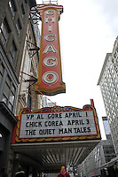 A woman in a headscarf walks passed the Chicago Theater, a Chicago landmark, at 175 N. State in Chicago, Illinois on March 23, 2009.