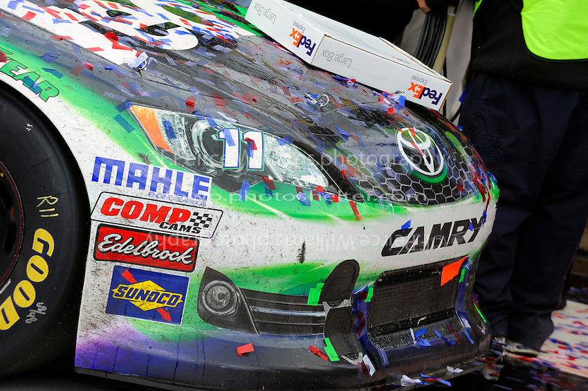The car of race winner Denny Hamlin, (#11) FedEx Ground Camry, in Victory Lane.