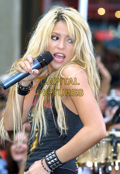 """SHAKIRA.Performs In Concert At The """"Today Show"""" Summer Concert Series 2002 At Rockefeller Plaza In New York City.singing, live, concert, music, microphone, half length, half-length.www.capitalpictures.com.sales@capitalpictures.com.©Capital Pictures"""