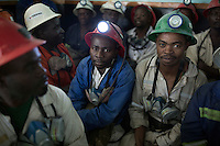 MUFULIRA, ZAMBIA- JULY 6: Mine workers wait to descend underground for an 8-hour shift mining copper in one of the shafts at Mopani on July 6, 2016. Glencore, an Anglo-Swiss multinational commodity trading and mining company, owns about 73 % of the mine, which produces copper and some cobalt. The mine employs about 15,000 people. (Photo by Per-Anders Pettersson)