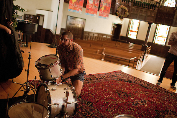 September 14, 2010.  Durham, North Carolina.. Pinson Chanselle, of FTBB, sets up his drums.. Day One of Sounds of the South, a reinterpretation of Alan Lomax's field recordings, with music by Megafaun, Fight the Big Bull, Sharon Van Etten and Justin Vernon of Bon Iver..