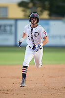 Kennon Menard (2) of the High Point-Thomasville HiToms hustles towards third base against the Asheboro Copperheads at Finch Field on June 12, 2015 in Thomasville, North Carolina.  The HiToms defeated the Copperheads 12-3. (Brian Westerholt/Four Seam Images)