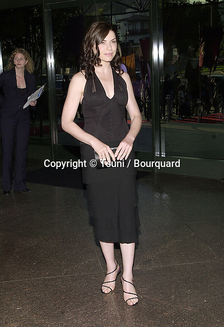 Julianna Marguiles arriving at the premiere of Mist of Avalon at the Director Guild of America in Los Angeles. The Mist of Avalon is the legendary story of Camelot seen through the eyes of the women who wielded power behind King Arthur throne. June 25, 2001  © TsuniMarguliesJulianna05.JPG