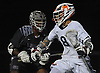 Louis Perfetto #8 of Manhasset, right, circles behind the net as Trevor Yeboah-Kodie #15 of Garden City pressures him during the 131st Woodstick Classic at Manhasset High School on Saturday, April 29, 2017. Manhasset won by a score of 10-8.