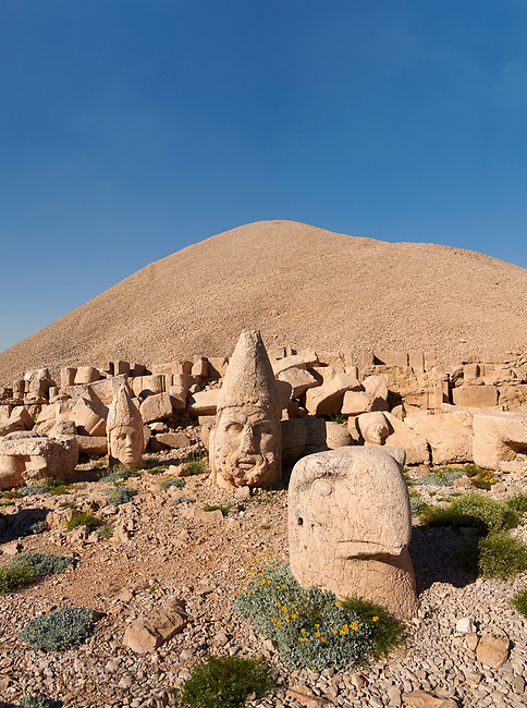 Statue head of from left, Apollo, Herekles & Eagle in front of the 62 BC Royal Tomb of King Antiochus I Theos of Commagene, west Terrace, Mount Nemrut or Nemrud Dagi summit, near Adıyaman, Turkey