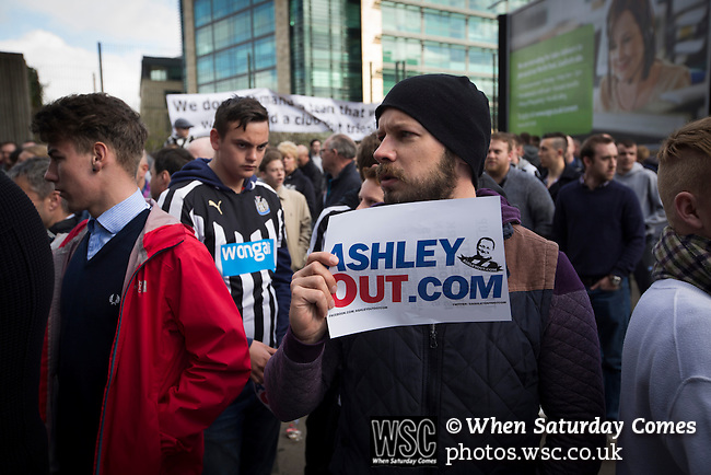 Newcastle United 1 Tottenham Hotspur 3 19/04/2015. St James Park, Premier League. A protestor holding a sign during a demonstration at the Gallowgate end of the stadium before Newcastle United host Tottenham Hotspurs in an English Premier League match at St. James' Park. The match was boycotted by a section of the home support critical of the role of owner Mike Ashley and sponsorship by a payday loan company. The match was won by Spurs by 3-1, watched by 47,427, the lowest league gate of the season at the stadium. Photo by Colin McPherson.
