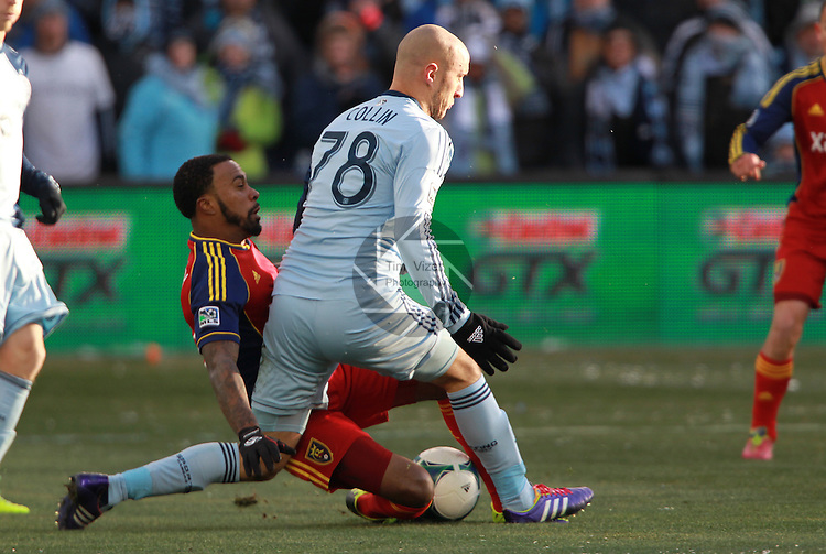 Real Salt Lake forward Robbie Findley (10, left) collides with Sporting KC defender Aurelien Collin (78) in first half action as Collin tries to steal the ball from Findley. Sporting KC defeated Real Salt Lake in a shootout after the score was tied 1-1 at the end of regulation play in the MLS Cup 2013 championship held at Sporting Park in Kansas City, Kansas on Saturday December 7, 2013.