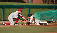 """STOCKTON, CA - May 9, 2011: Stephen Piscotty of Stanford baseball tags out a Pacific runner attempting to steal third during Stanford's game against Pacific at Klein Family Field in Stockton. The play was a """"strike him out, throw him out"""" play. Stanford won 11-5."""