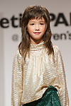 Model walks runway in an outfit from the Florence Fancy collection during the petitePARADE fashion show at Children's Club in the Jacob Javits Center in New York City on February 25, 2018.