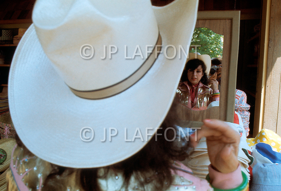 Nashville, Tennessee - June 10, 1977. This photograph was taken of Yvette Horner when she was trying on a hat in Nashville, Tennessee, where she was scheduled to play at the Ole Opry. Yvette Horner (born September 22nd, 1922) is a renown French accordionist, whose career has spanned over 70 years, has given thousands of concerts around the world and sold over 30 million records.