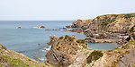 Rocky rugged coastline near fishing port village of Azenha do Mar,  Alentejo Littoral, Portugal, southern Europe