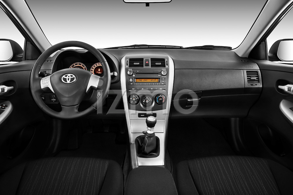 Straight dashboard view of a 2010 Toyota Corolla Linea Sol 4 Door Sedan.